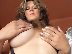 A HUGE TITS TRANNY in pink stockings strokes and CUMS