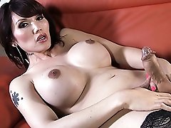Busty Eva fingers and strokes