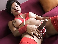 Seductive tgirl Carmen Moore playing with herself