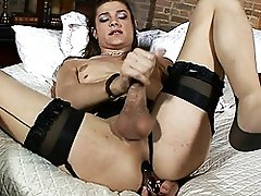 Horny TS fucking her tight asshole with a glass toy