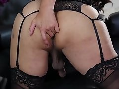 Vaniity takes off her sexy black corset and teases you with her juicy tgirl dick