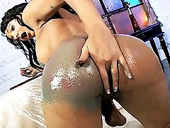 TS Sunshyne fingering her body painted ass