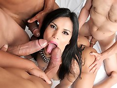 Watch the beautiful Bruna Butterfly get fucked in her first ganbang!